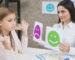 smiling-psychologist-showing-happy-sad-emotion-faces-cards-girl-child_23-2148026262